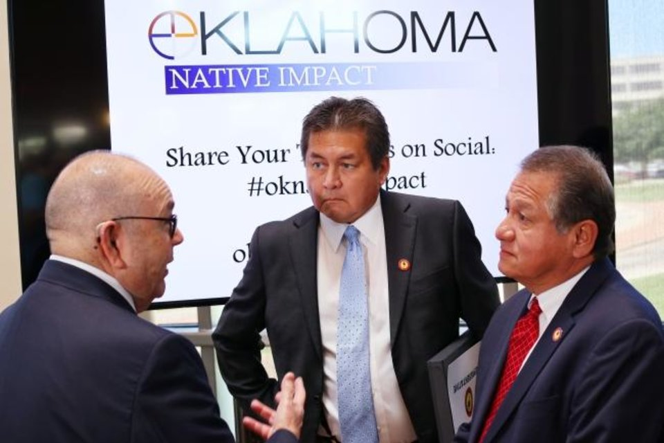 Photo -  Chickasaw Nation Gov. Bill Anoatubby, center, speaks with Absentee Shawnee Tribe of Oklahoma Treasurer Phillip Ellis and Secretary John Johnson at the Oklahoma Tribal Finance Consortium. [DOUG HOKE/THE OKLAHOMAN]