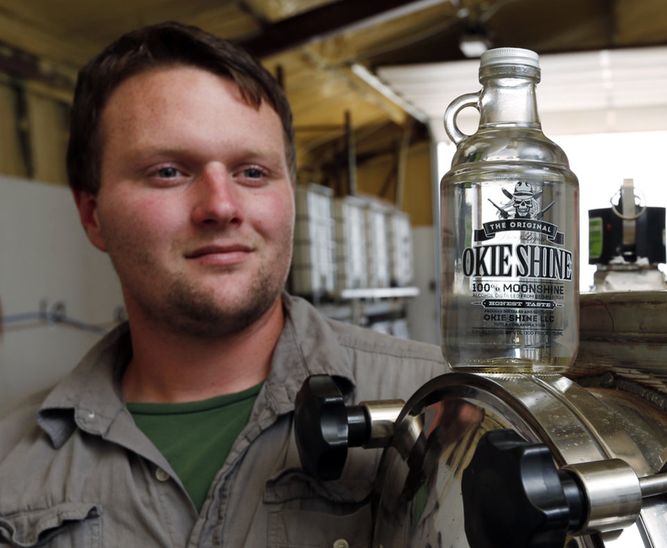Photo -  Ricky Sowers talks Wednesday about his Okie Shine distillery in Tuttle. Sowers says Okie Shine is the first legal distiller of moonshine in the state. [Photo by Steve Sisney, The Oklahoman]