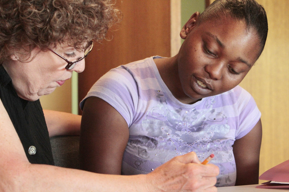 Photo - Instructor Kay Walls works with Tina Roberts, a student in a TANF basic skills class in literacy and math through Community Literacy Centers and DHS, at Britton Christian Church. Photo By David McDaniel, The Oklahoman  David McDaniel