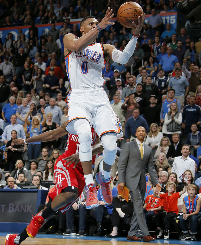 Photo - Oklahoma City's Russell Westbrook (0) goes to the basket past during an NBA basketball game between the Oklahoma City Thunder and the Houston Rockets at Chesapeake Energy Arena in Oklahoma City, Friday, Jan. 29, 2016. Oklahoma City won 116-108. Photo by Bryan Terry, The Oklahoman