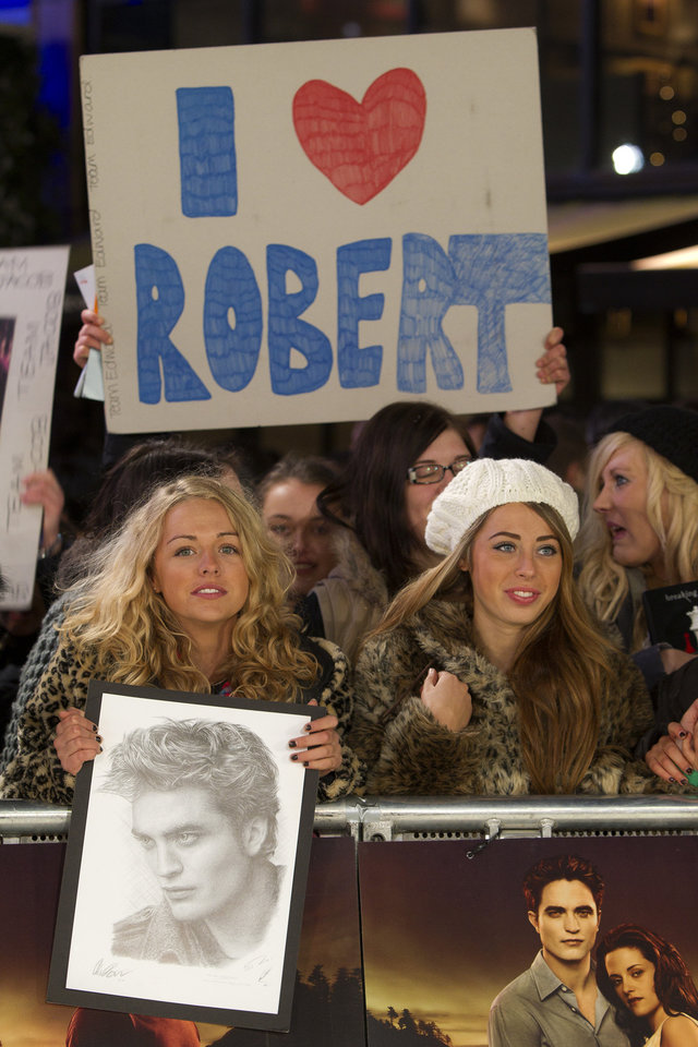 Photo - Fans await at the UK film premiere of 'Twilight Breaking Dawn part 1' at Westfield Stratford in east London, Wednesday, Nov. 16, 2011. (AP Photo/Joel Ryan) ORG XMIT: LENT102