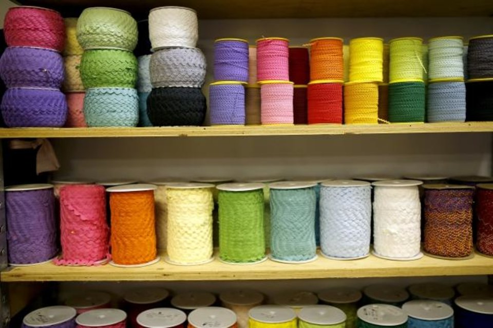 Photo -  Supplies are stacked on shelves at the OKC Fabric Market. [SARAH PHIPPS/THE OKLAHOMAN]