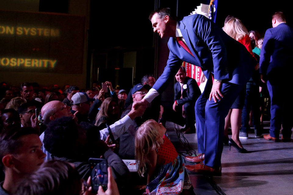 Photo - Kevin Stitt shakes hands after giving his acceptance speech during the Republican election night watch party for the 2018 elections at the Bricktown Events Center in Oklahoma City, Nov. 6, 2018. Photo by Bryan Terry, The Oklahoman