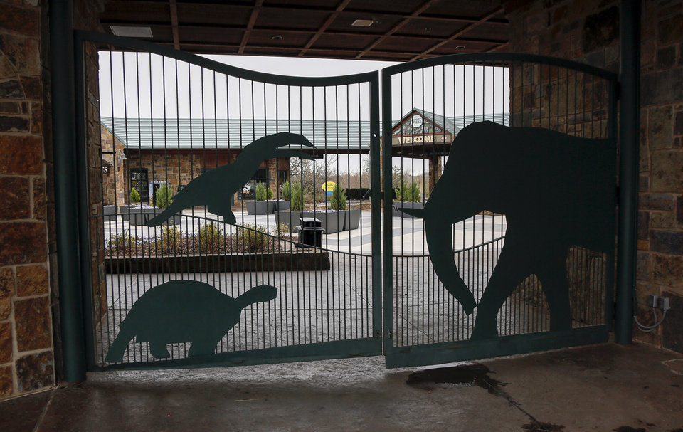 Photo - Gates to the Oklahoma City Zoo are closed in Oklahoma City, Monday, March 16, 2020. The zoo is closed because of the coronavirus pandemic and plans to tentatively reopen on March 23. [Nate Billings/The Oklahoman]