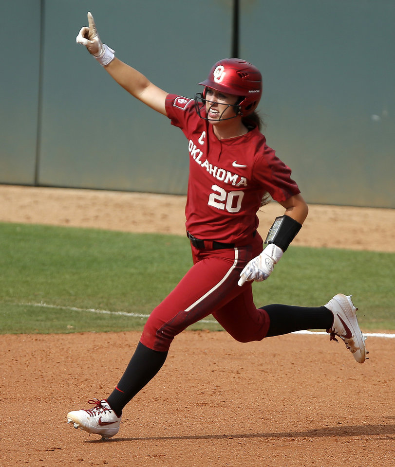 Photo - Oklahoma's Caleigh Clifton (20) celebrates after hitting a home run in the sixth inning of the second softball game in the Norman Super Regional between the University of Oklahoma (OU) and Northwestern in Norman, Okla., Saturday, May 25, 2019. Oklahoma won 8-0 to send them to the Women's College World Series. [Bryan Terry/The Oklahoman]