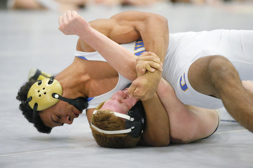 Photo - Choctaw's Gabe Johnson, top, wrestles Broken Arrow's Chris Moores in the Class 6A 145-pound match of the Dual State Wrestling Tournament at Firelake Arena in Shawnee, Okla., Saturday, Feb. 9, 2019. Photo by Bryan Terry, The Oklahoman