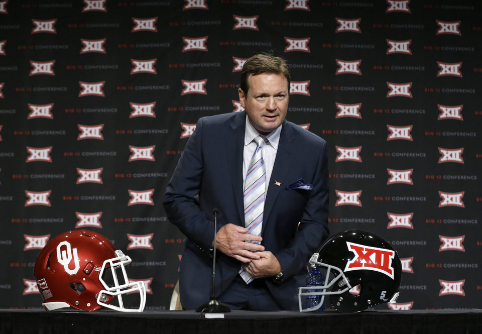 Photo - Oklahoma head coach Bob Stoops takes a seat on the main stage before speaking to reporters at the Big 12 Conference NCAA college football media days in Dallas, Tuesday, July 22, 2014. (AP Photo)
