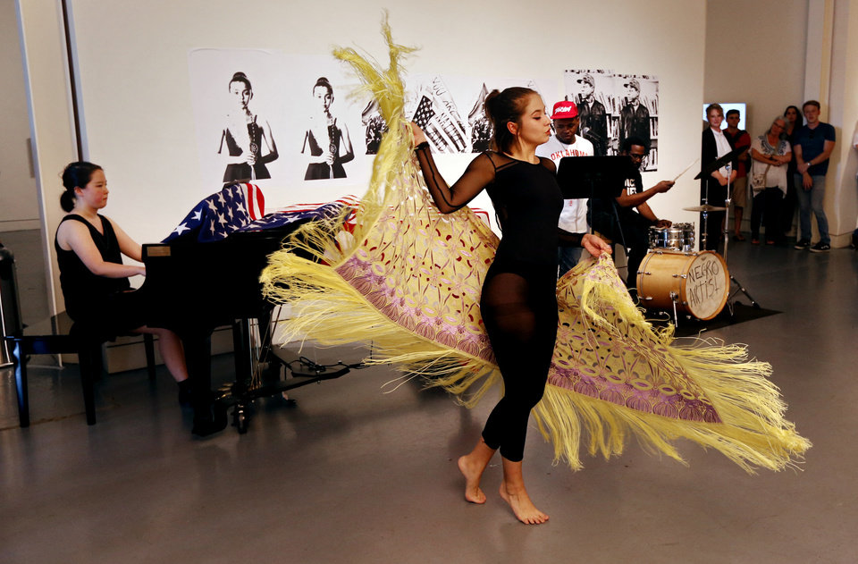 Photo -  A dancer performs June 9 during a live presentation by 2017