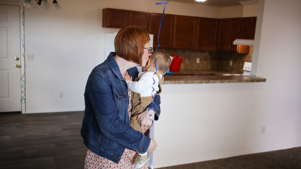 Photo - Brittani Githiri kisses her one year old son, Piaget, as she stands in her finished house after the ceremony and the crowd had gone. The house is Habitat for Humanity's 1,000th home in Oklahoma City. [Photo by Doug Hoke/The Oklahoman]