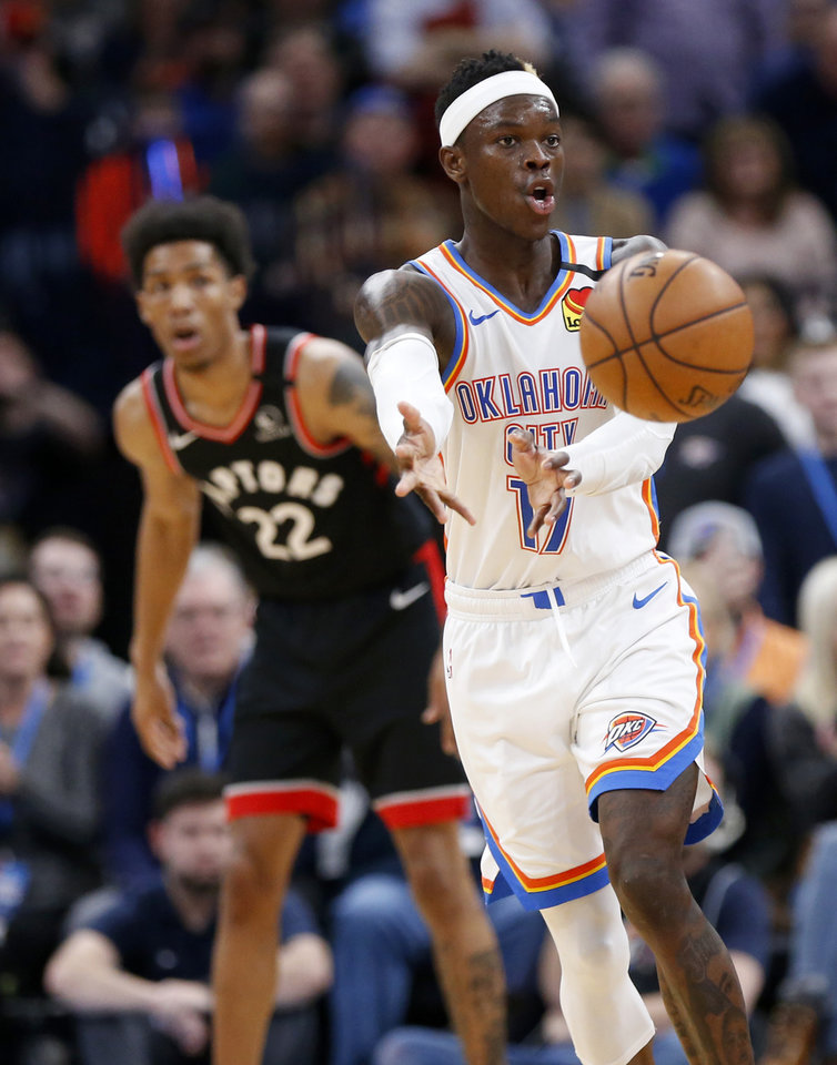 Photo - Oklahoma City's Dennis Schroder (17) passes in the third quarter during an NBA basketball between the Oklahoma City Thunder and the Toronto Raptors at Chesapeake Energy Arena in Oklahoma City, Wednesday, Jan. 15, 2020. Toronto won 130-121. [Nate Billings/The Oklahoman]