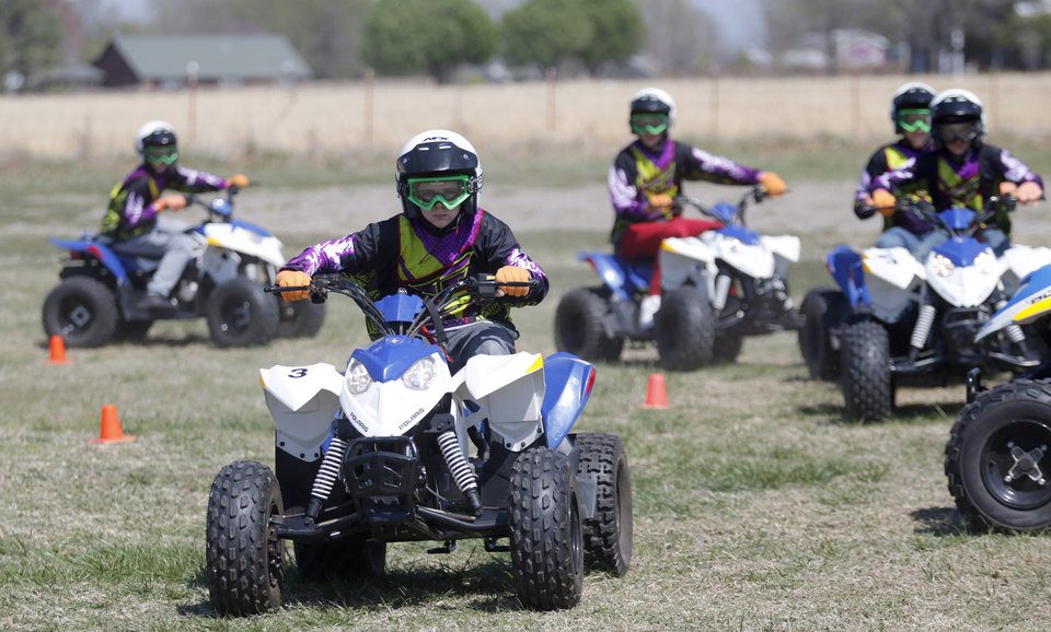 Photo -  Ashton Keegan, 13, rides during the ATV safety class in Claremore. [Photo by Sarah Phipps, The Oklahoman]