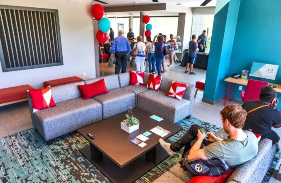 Photo -  The lounge of the new Avid Hotel is shown during its grand opening celebration.