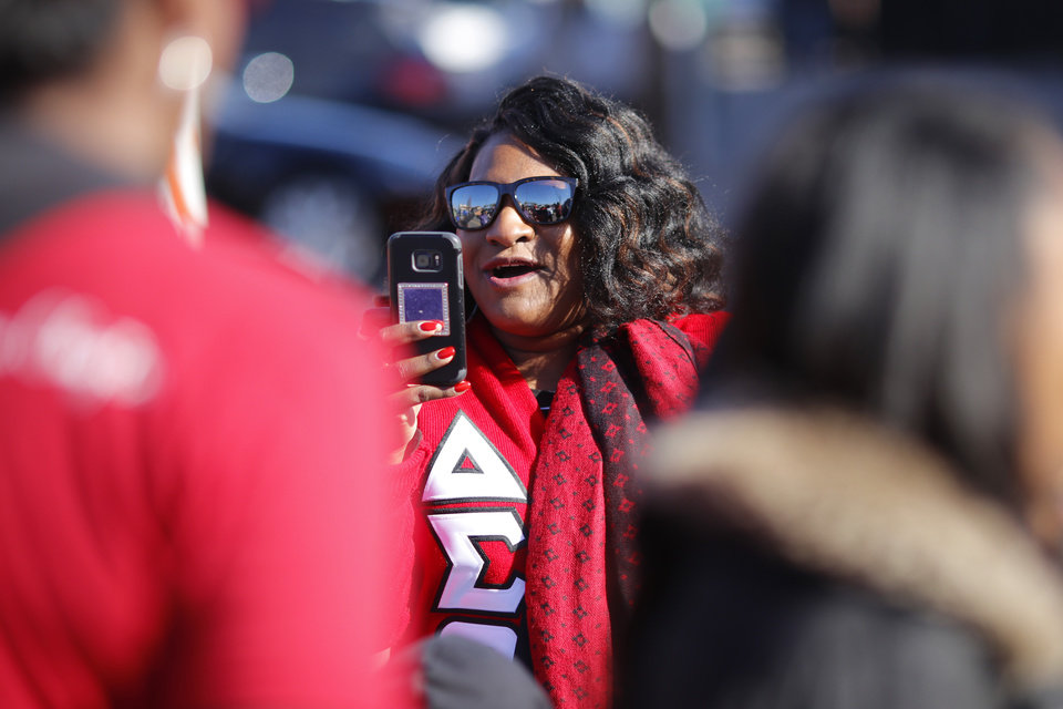 Photo - Kameelah Alexander, from Wichita, cheers for her Delta Sigma Theta sisters from Langston along the route for the MLK Day Parade along Walker Ave. during celebrations of Dr. Martin Luther King, Jr. holiday, Monday, January 20, 2019. [Photo by Doug Hoke/The Oklahoman]