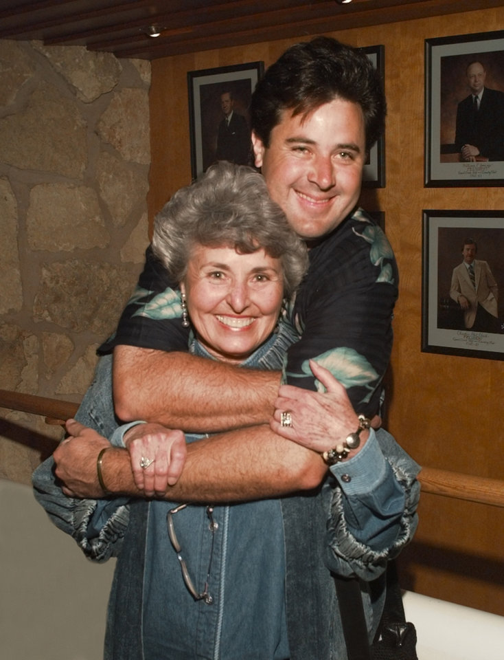 Photo - Vince Gill and mom Jerene Gill pose for a photo Monday, April 27, 1998. [The Oklahoman Archives photo]