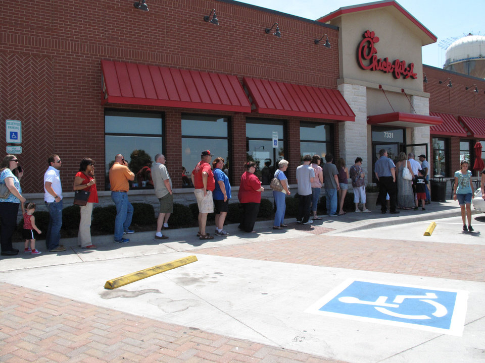Photo - People wait in line about 12:30 p.m. Wednesday outside the Chick-fil-A at 7331 SE 29 in Midwest City. Photo by Carla Hinton, The Oklahoman