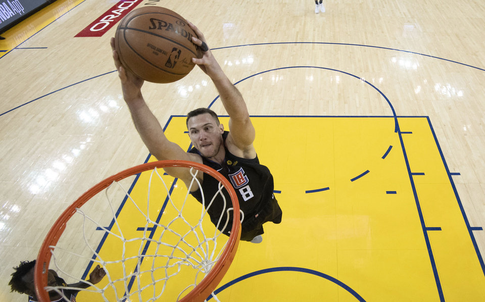 Photo - Los Angeles Clippers forward Danilo Gallinari (8) dunks against the Golden State Warriors during the second half of Game 2 of a first-round NBA basketball playoff series in Oakland, Calif., Monday, April 15, 2019. (Kyle Terada/Pool Photo via AP)