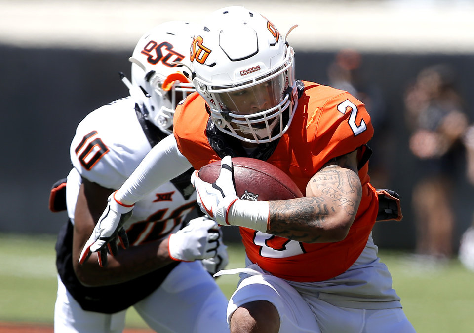 Photo - Oklahoma State's Tylan Wallace (2) gets by Oklahoma State's Tyrell Alexander (10) during the Oklahoma State Cowboys spring practice at Boone Pickens Stadium in Stillwater, Okla., Saturday, April 20, 2019.  Photo by Sarah Phipps, The Oklahoman