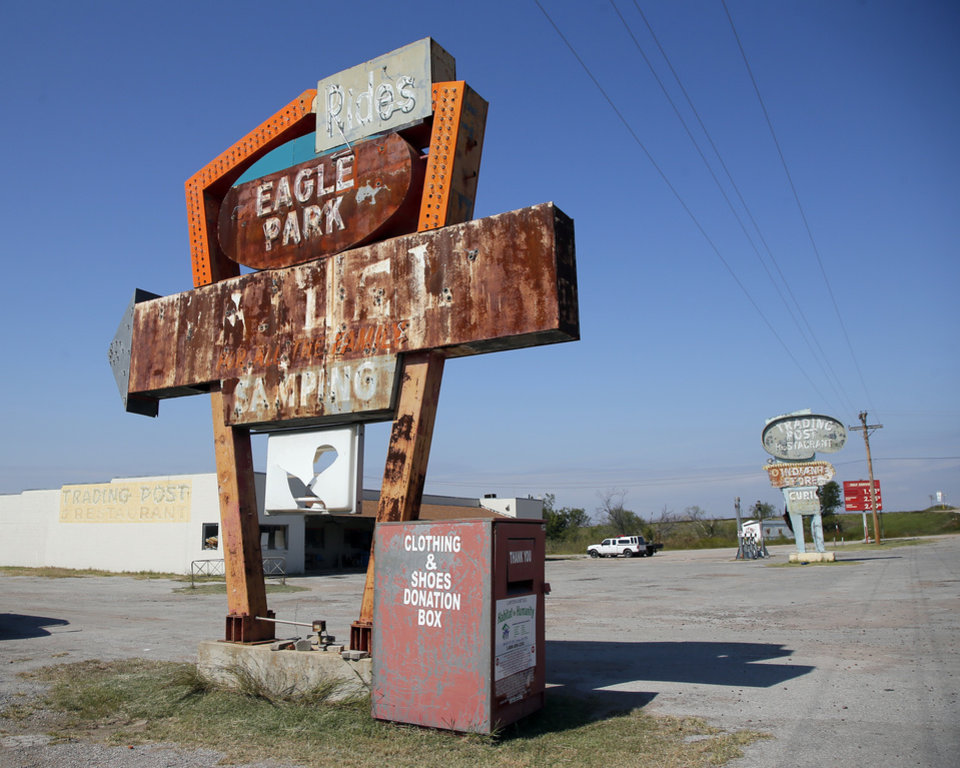 Photo -  The sign for Eagle Park, a closed amusement park, and the Trading Post run by Wayne Gipson, who owns and gives tours of the Quanah Parker Star House. [Photo by Nate Billings, The Oklahoman]