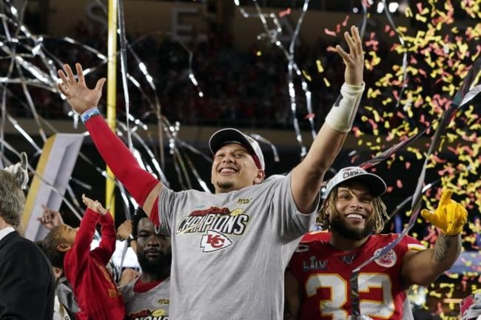 Photo -  Patrick Mahomes, left, and Tyrann Mathieu celebrate the Chiefs' Super Bowl victory. [AP Photo/David J. Phillip]