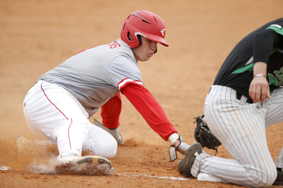 Photo - Kingston's Jase Hayes slides to third base during a Class 3A state baseball game against Jones at Edmond Memorial in Edmond, Okla., Thursday, May 9, 2019. [Bryan Terry/The Oklahoman]