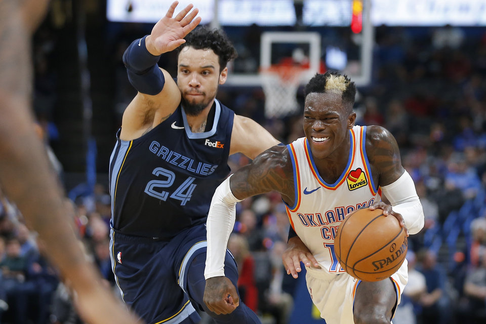 Photo - Oklahoma City's Dennis Schroder (17) goes past Memphis' Dillon Brooks (24) during an NBA basketball game between the Oklahoma City Thunder and the Memphis Grizzlies at Chesapeake Energy Arena in Oklahoma City, Wednesday, Dec. 18, 2019. Oklahoma City won 126-122. [Bryan Terry/The Oklahoman]