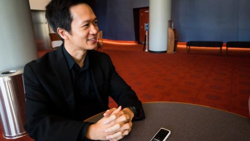 Photo -  Oklahoma City Philharmonic concertmaster Gregory Lee speaks during an interview at the Civic Center Music Hall. [Photo by Ulises Serrano]