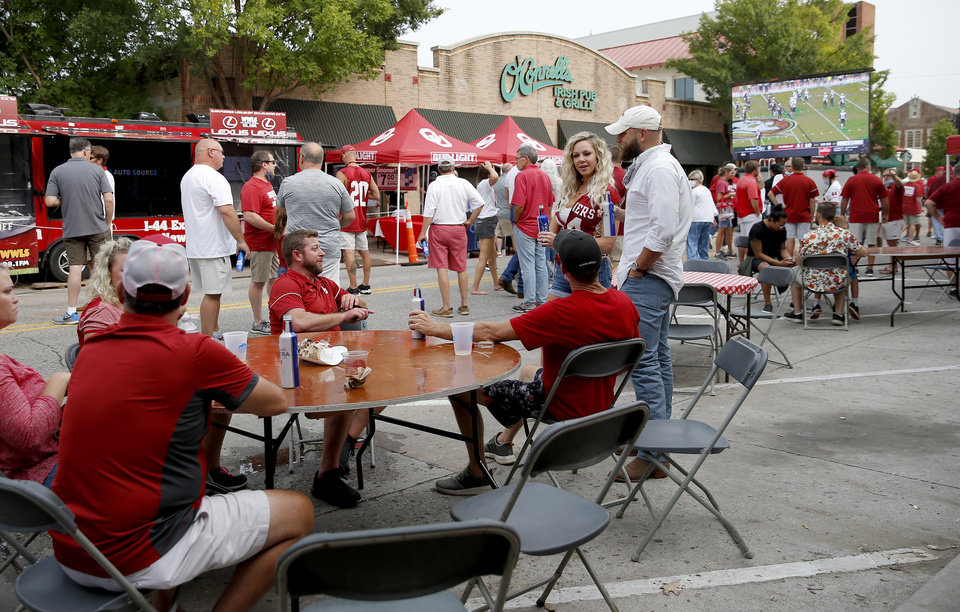Photo - People gather at Campus Corner before a college football game between the University of Oklahoma Sooners (OU) and Missouri State in Norman, Okla., Saturday, Sept. 12, 2020. [Bryan Terry/The Oklahoman]