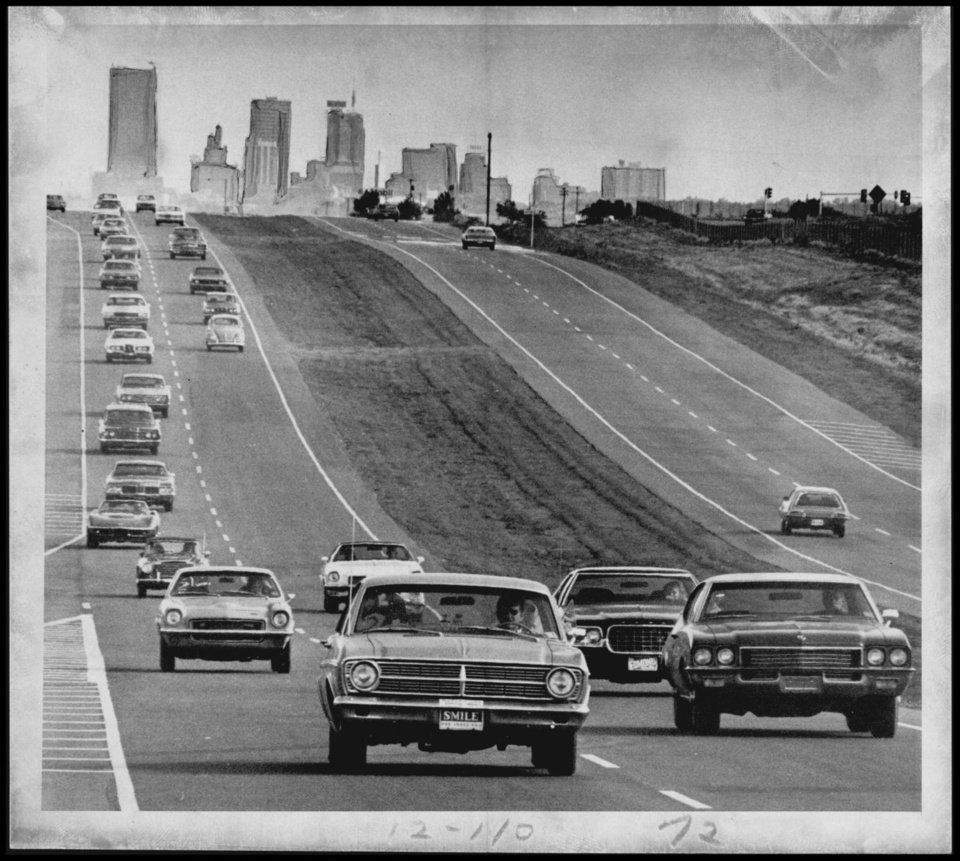 Photo - HIGHWAYS / CITY / BROADWAY EXTENSION: UNKNOWN: Caption reads, TRAFFIC FLOWS along the new three-mile stretch of the Broadway Extension which was opened Friday between Britton Road and Memorial Road. Staff Photo by Hank Mooney. Original Photo 07/19/1973. Published on O-7-21-73.