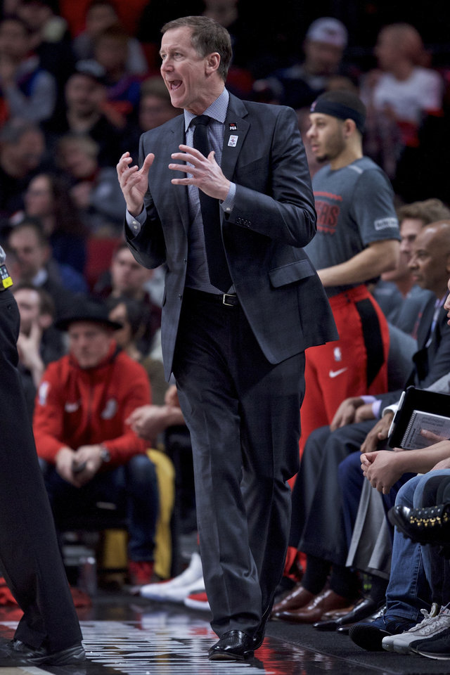 Photo - Portland Trail Blazers coach Terry Stotts gestures during the first half of the team's NBA basketball game against the Oklahoma City Thunder in Portland, Ore., Thursday, March 7, 2019. (AP Photo/Craig Mitchelldyer)