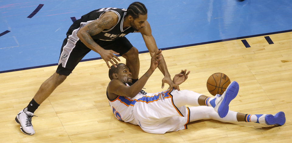 Photo - Oklahoma City's Kevin Durant (35) and San Antonio's Kawhi Leonard (2) fight for a loose ball during Game 4 of the Western Conference semifinals between the Oklahoma City Thunder and the San Antonio Spurs in the NBA playoffs at Chesapeake Energy Arena in Oklahoma City, Sunday, May 8, 2016. Photo by Sarah Phipps, The Oklahoman