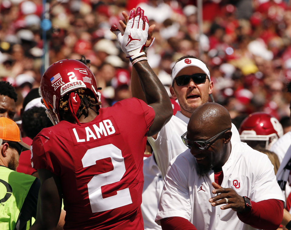 b608987d1 Head coach Lincoln Riley congratulates the play of CeeDee Lamb (2) during a  college football game between the University of Oklahoma Sooners (OU) and  the ...