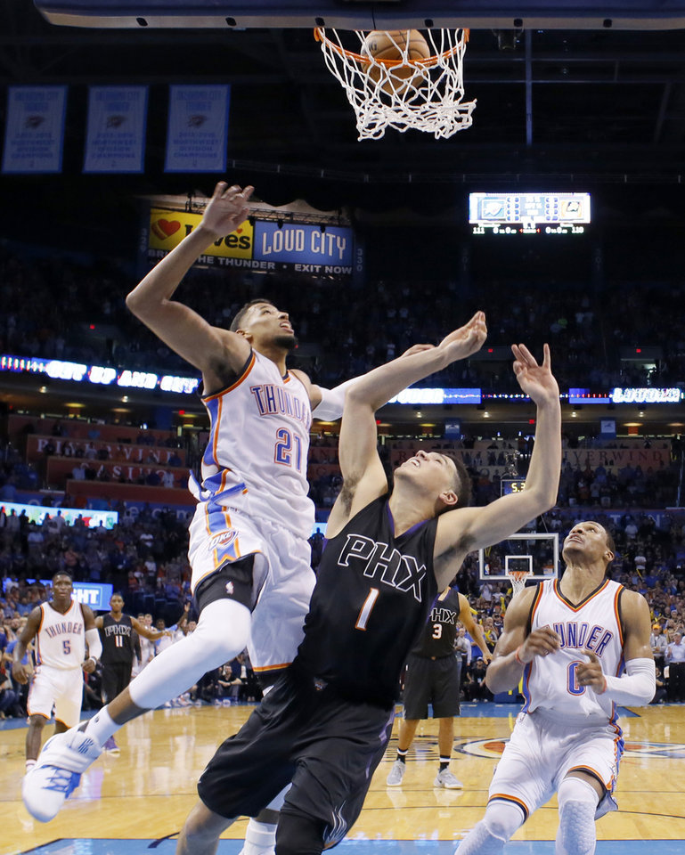 Photo - Oklahoma City's Andre Roberson (21) blocks the last shot of Phoenix's Devin Booker (1) and Russell Westbrook (0) watches during an NBA basketball game between the Oklahoma City Thunder and the Phoenix Suns at Chesapeake Energy Arena in Oklahoma City, Friday, Oct. 28, 2016. Photo by Bryan Terry, The Oklahoman