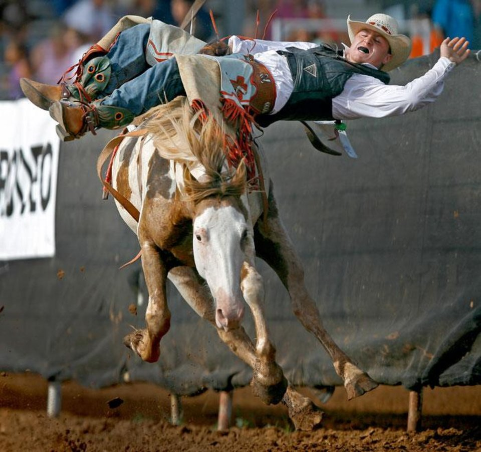 Photo -  Josh Loftin of Collinsville, Oklahoma, competes in the bareback bronc event during the International Finals Youth Rodeo in Shawnee, Okla., Friday, July 16, 2010.  Photo by Bryan Terry, The  Oklahoman