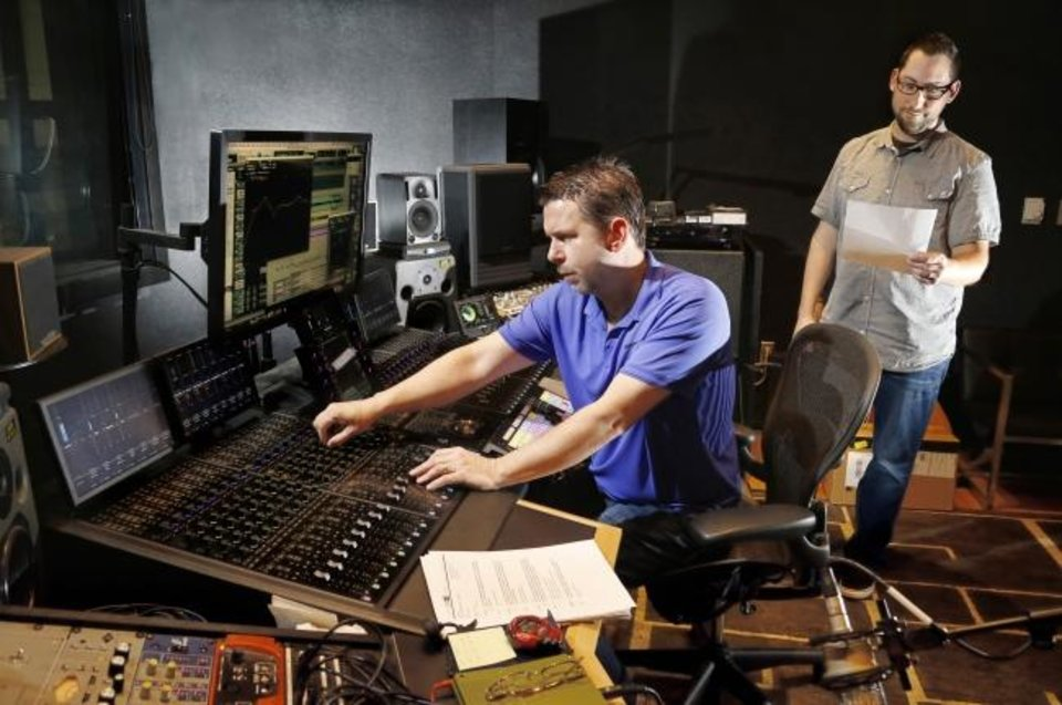 Photo -  Jason Bushore, left, and Wes DeWitte are shown mixing a music track in a control room at Ackerman McQueen, an advertising agency in Oklahoma City. [Jim Beckel/The Oklahoman]