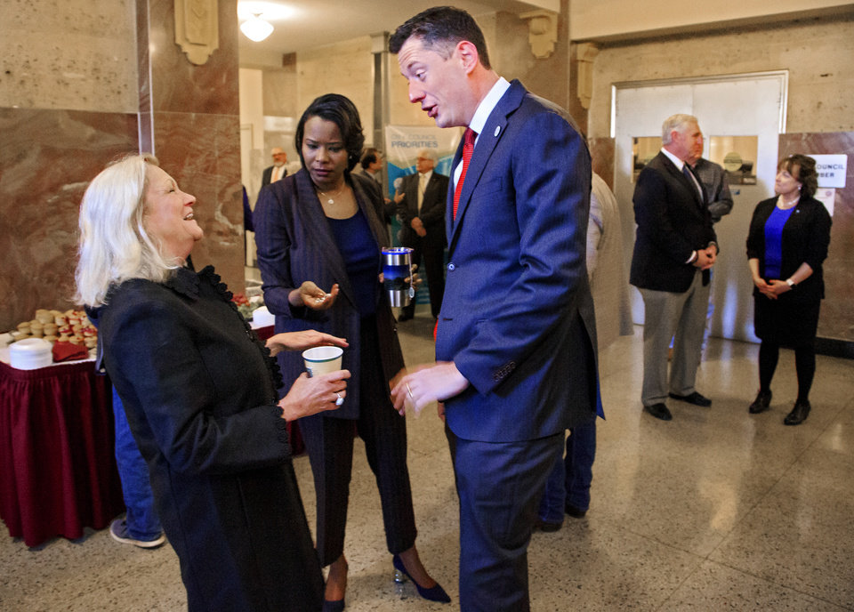 Photo - Ward 6 councilwoman Meg Salyer speaks to Mayor David Holt during a reception that precedes her last council meeting at City Hall in Oklahoma City, Okla. on Tuesday, March 26, 2019.  Salyer did not seek re-election after serving 11 years on the council.  Photo by Chris Landsberger, The Oklahoman