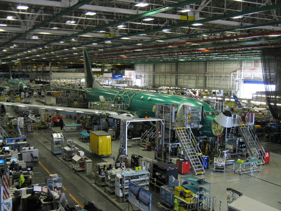 Photo -  The 100th P-8 Poseidon goes through the assembly process at Boeing's manufacturing facility in Renton, Wash. The P-8 is based on Boeing's 737-800 airframe, but has a beefier fuselage and other structural upgrades to handle the military gear the U.S. Navy uses to conduct the aircraft's mission. [Photo by Jack Money, The Oklahoman]