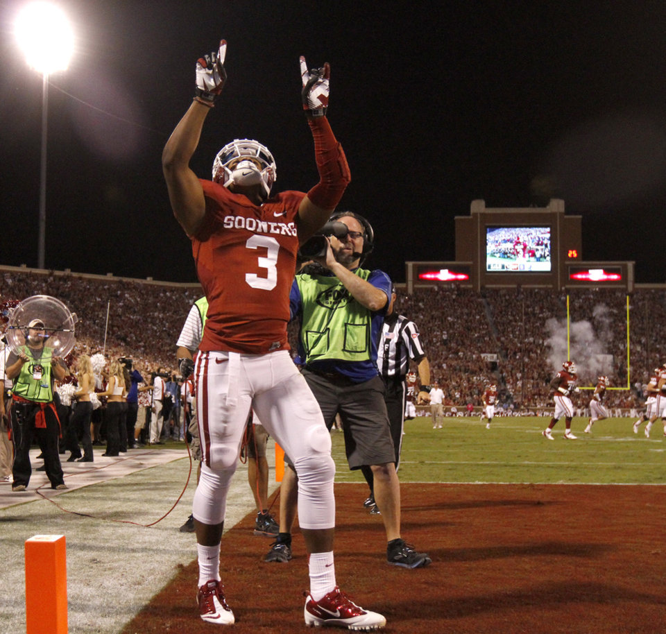 Photo - OU's Sterling Shepard (3) celebrates after a touchdown during the college football game between the University of Oklahoma Sooners (OU) and the Kansas Jayhawks (KU) at Gaylord Family-Oklahoma Memorial Stadium in Norman, Okla., Saturday, Oct. 20, 2012. Photo by Bryan Terry, The Oklahoman