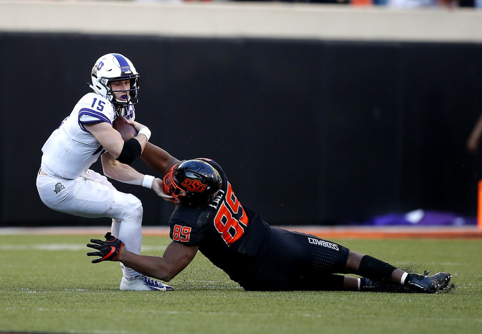Photo - Oklahoma State's Tyler Lacy (89) sacks TCU's Max Duggan (15) in the fourth quarter during the college football game between the Oklahoma State University Cowboys and the TCU Horned Frogs at Boone Pickens Stadium in Stillwater, Okla.,  Saturday, Nov. 2, 2019. OSU won 34-27. [Sarah Phipps/The Oklahoman]