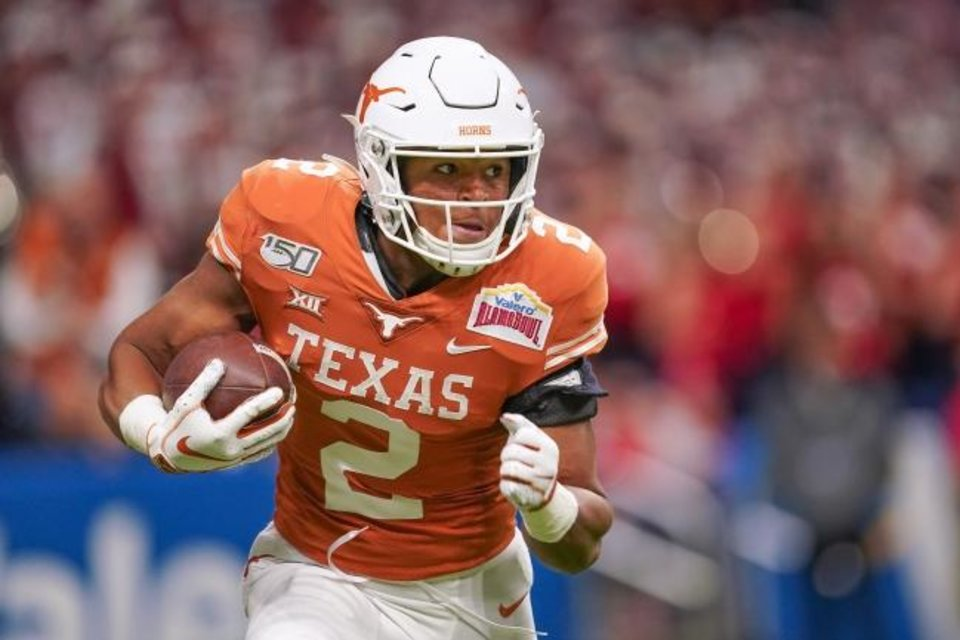 Photo -  Texas running back Roschon Johnson is averaging 5.2 yards per carry this season. [Daniel Dunn/USA TODAY Sports]