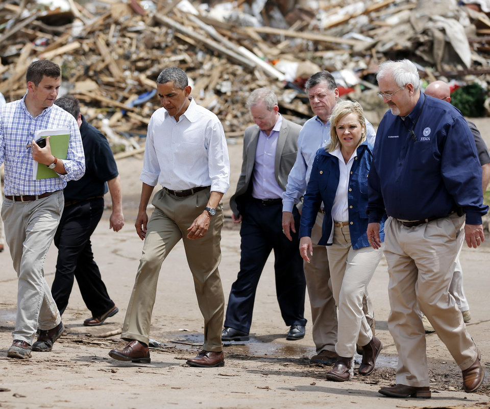 Photo - President Barack Obama walks towards the Plaza Towers School in Moore, Okla.,with Oklahoma officials on Sunday, May 25, 2013. Photo by Bryan Terry The Oklahoman