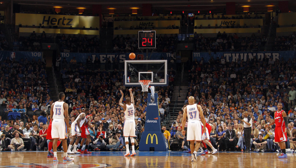 Photo - Oklahoma City Thunder small forward Kevin Durant (35) shoots free throws during the NBA basketball game between the Oklahoma City Thunder and the Los Angeles Clippers at Chesapeake Energy Arena on Wednesday, March 21, 2012 in Oklahoma City, Okla.  Photo by Chris Landsberger, The Oklahoman