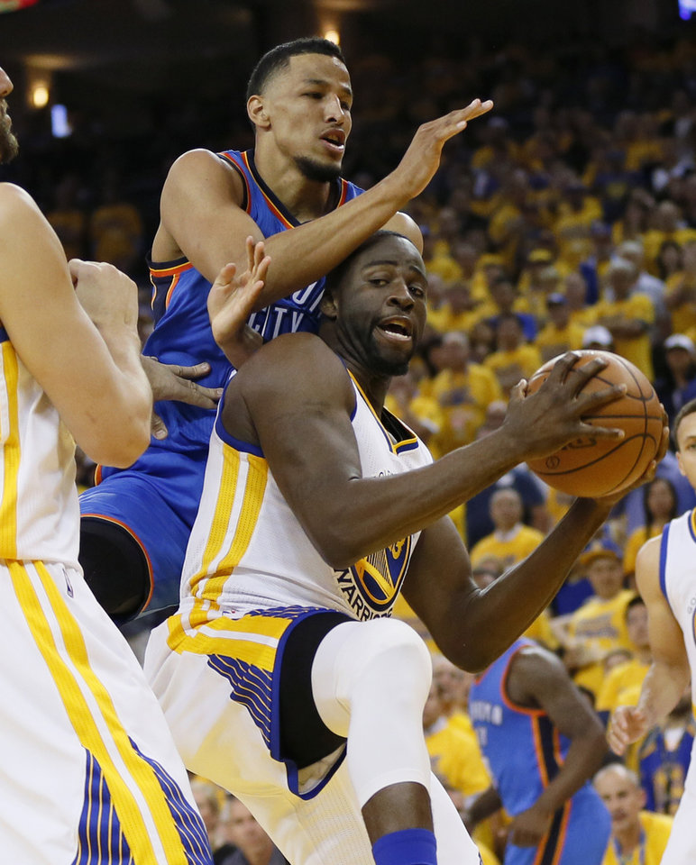 Photo - Golden State's Draymond Green (23) grabs a rebound under Oklahoma City's Andre Roberson (21) during Game 5 of the Western Conference finals in the NBA playoffs between the Oklahoma City Thunder and the Golden State Warriors at Oracle Arena in Oakland, Calif., Thursday, May 26, 2016. Photo by Nate Billings, The Oklahoman