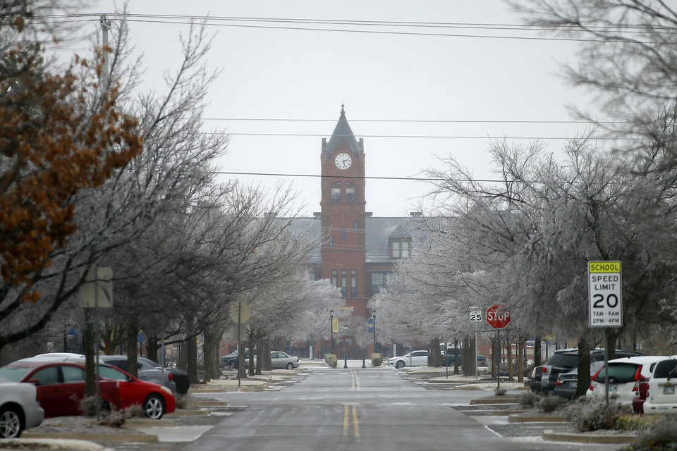 Photo - A layer of ice covers the street and trees west of Old North at the University of Central Oklahoma in Edmond, Okla., Wednesday, Feb. 10, 2021. [Bryan Terry/The Oklahoman]