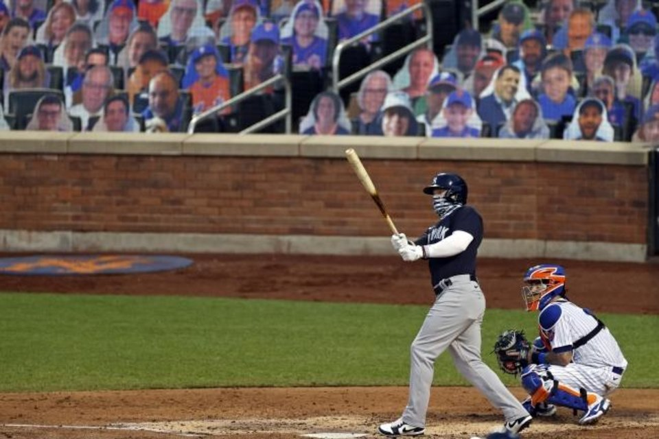 Photo -  New York Yankees slugger Clint Frazier watches his two-run home run during an exhibition Saturday against the New York Mets. Thursday night, the Yankees and Nationals will open the 2020 Major League Baseball season. [AP PHOTO/ADAM HUNGER]
