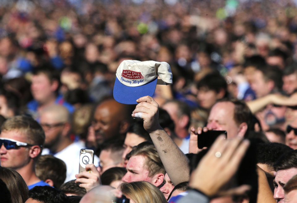3fe7d4999 A Chicago Cubs fan holds up an opening night cap during a celebration in Grant  Park