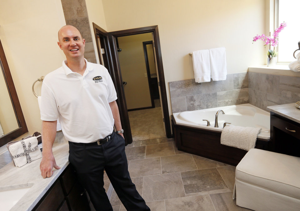 Aaron Evans, Of Evans Fine Homes, Shows The Master Bath At A Model Home At  11125 Katie Beth Lane. [PHOTO BY NATE BILLINGS, THE OKLAHOMAN] ...