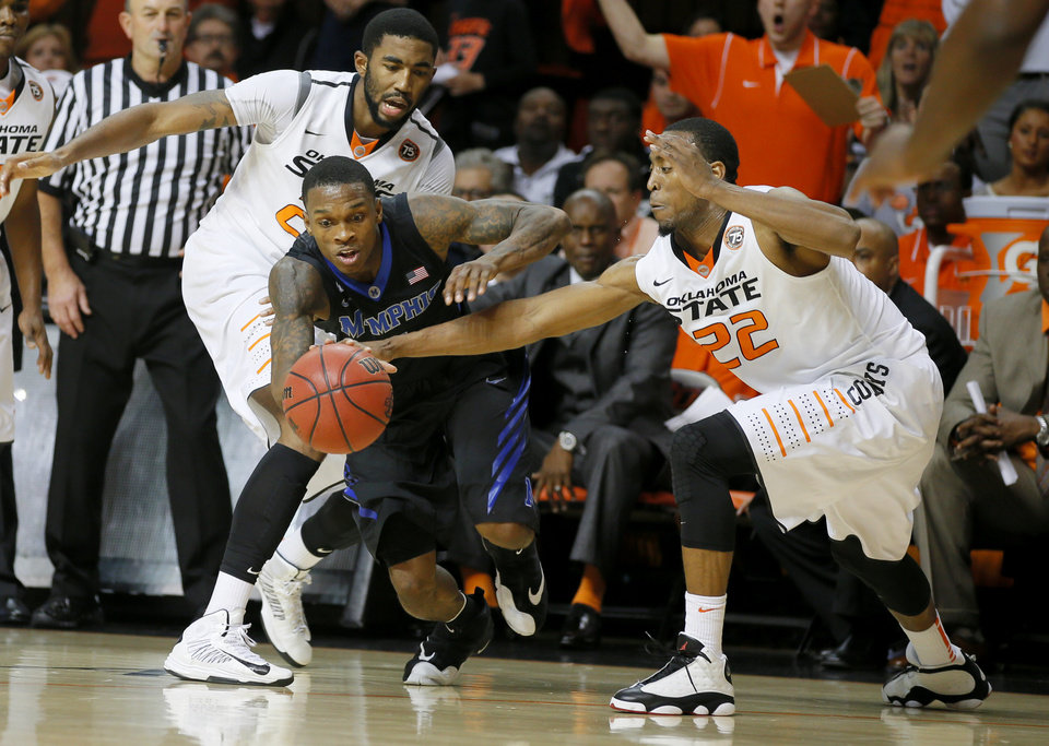 Photo - Oklahoma State's Michael Cobbins (20) and Markel Brown (22) defend Memphis' Joe Jackson (1) during an NCAA college basketball game between Oklahoma State and Memphis at Gallagher-Iba Arena in Stillwater, Okla., Tuesday, Nov. 19, 2013. Photo by Bryan Terry, The Oklahoman