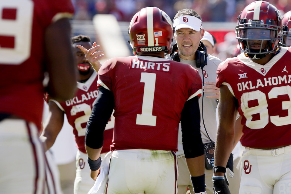 Photo - Oklahoma coach Lincoln Riley talks with Jalen Hurts during a game between the Sooners and West Virginia in September. Hurts threw for 395 yards against Kansas State in a 48-41 loss Saturday. [OKLAHOMAN ARCHIVES]