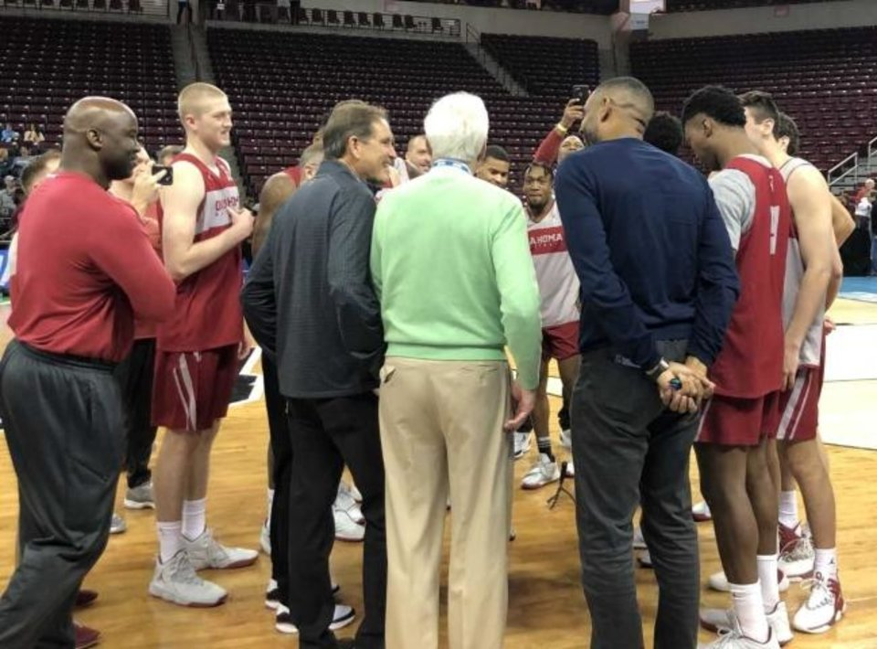 Photo -  Jim Nantz, left,, Bill Raftery, center, and Grant Hill chat with the Sooners on Thursday. [Joe Mussatto/The Oklahoman]