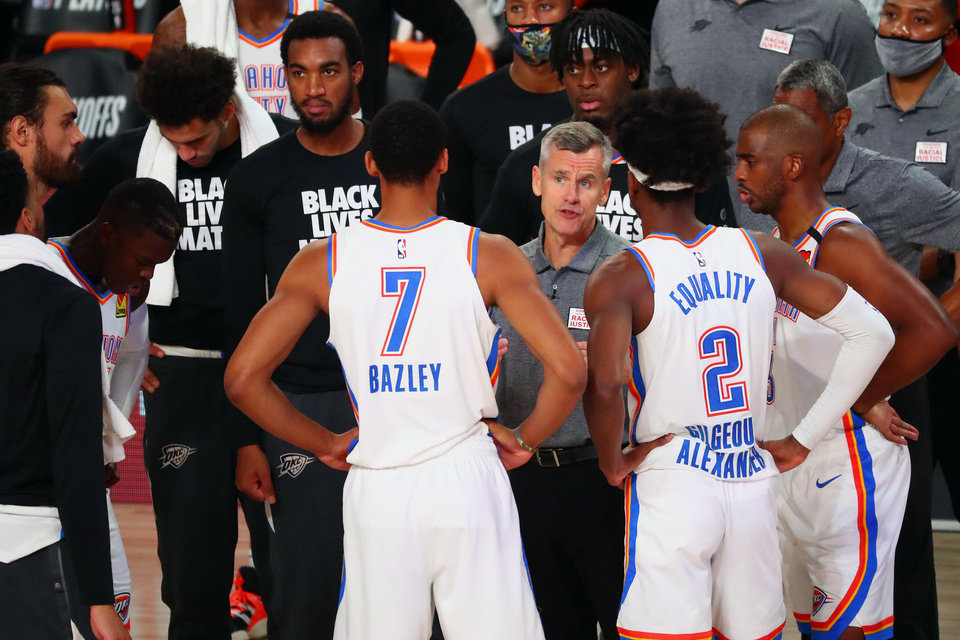 Photo - Aug 24, 2020; Lake Buena Vista, Florida, USA; Oklahoma City Thunder head coach Billy Donovan (middle right) huddles with his team during the first half in game four of the first round of the 2020 NBA Playoffs against the Houston Rockets at AdventHealth Arena. Mandatory Credit: Kim Klement-USA TODAY Sports